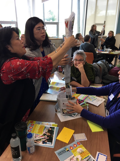 Participants in BRN's Richmond workshop having fun with an experiential game exploring community collaboration.