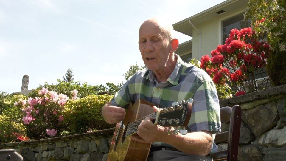 Victoria Resident Jeff Stevenson entertains neighbours along the Gorge Waterway.